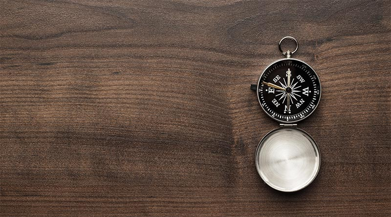 compass-on-table